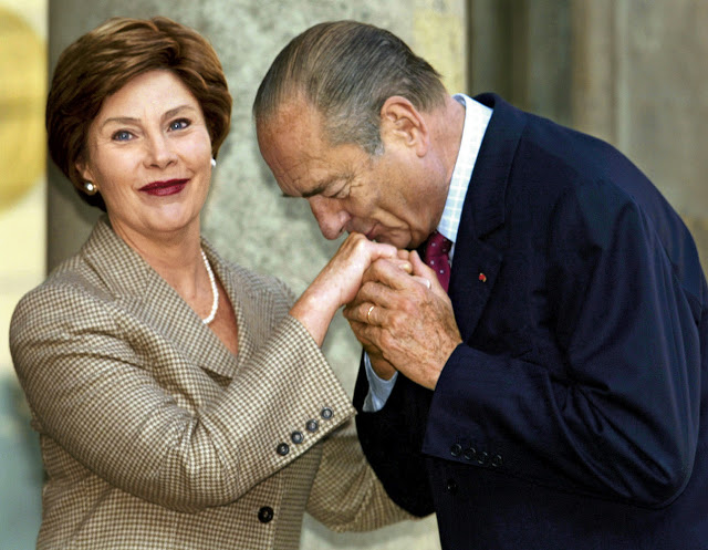 French President Chirac kissing the hand of Laura Bush
